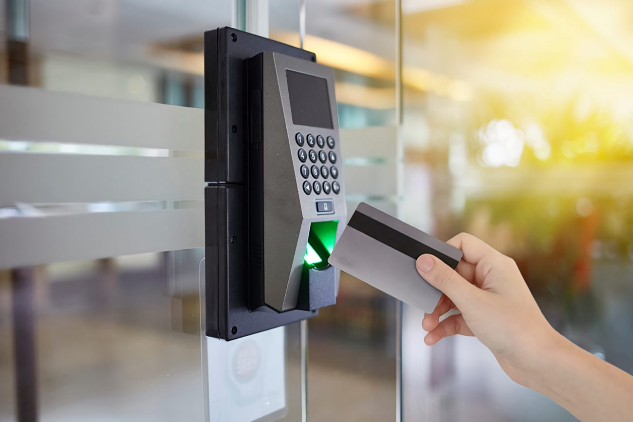 swiping access control card on security keypad reader