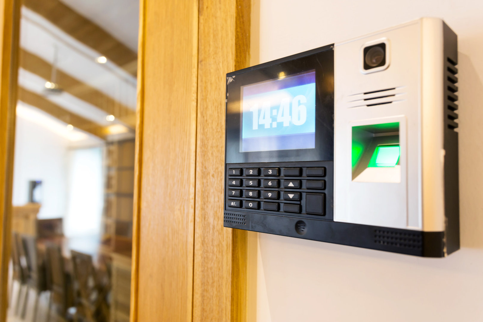 biometric fingerprint reader mounted on office wall