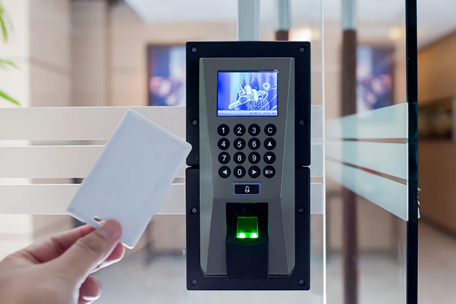 microngroup technician swiping access control keypad reader
