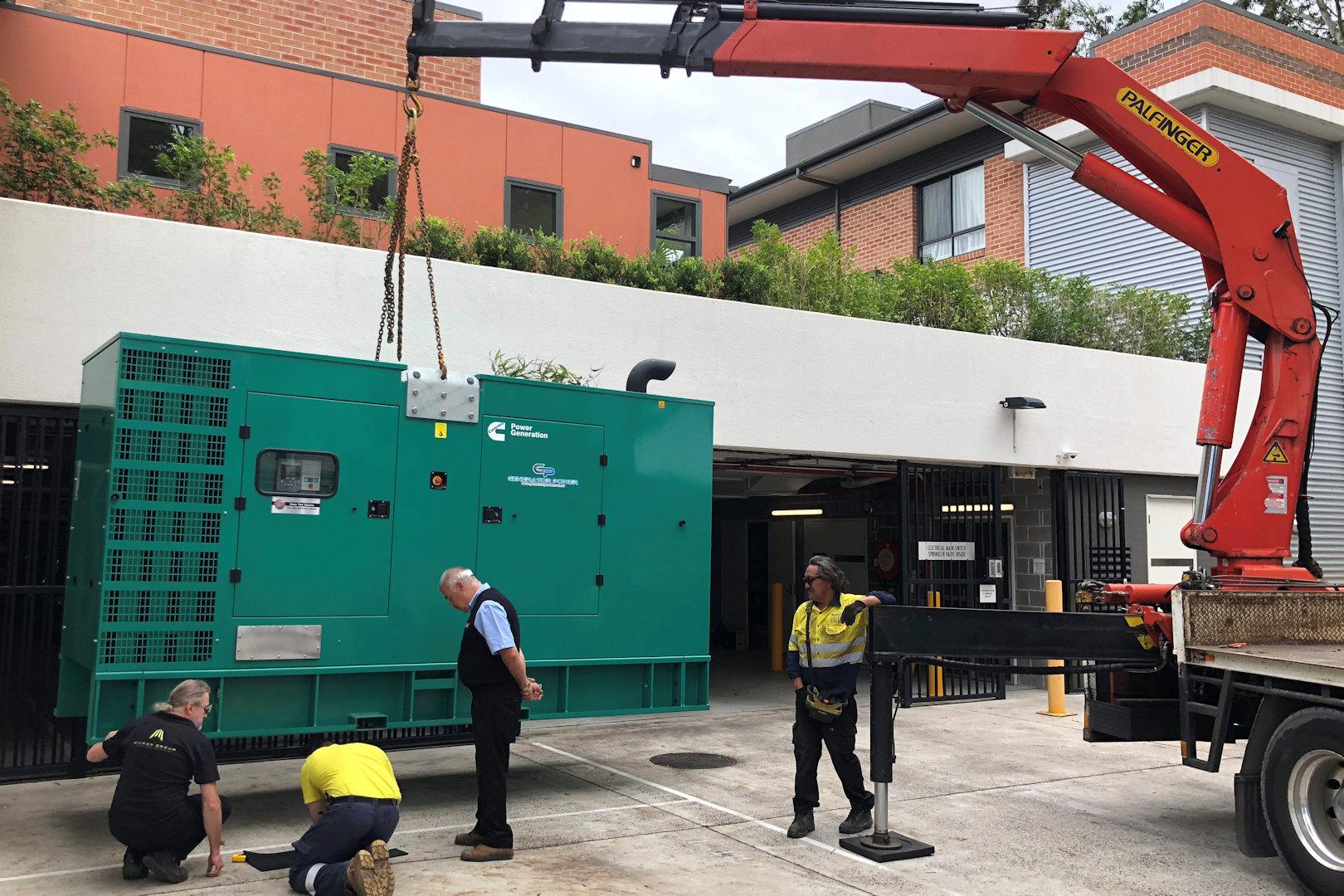 microngroup-cummins-diesel-generator-istallation-with-crane