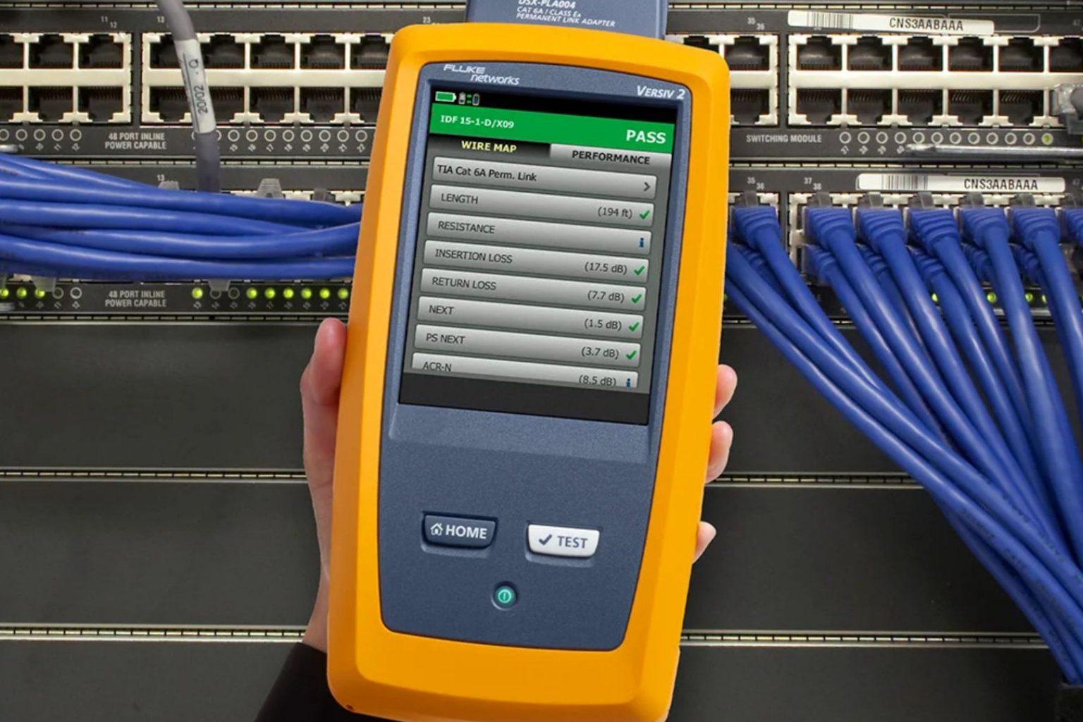 microngroup technician using fluke dsx versiv data network tester