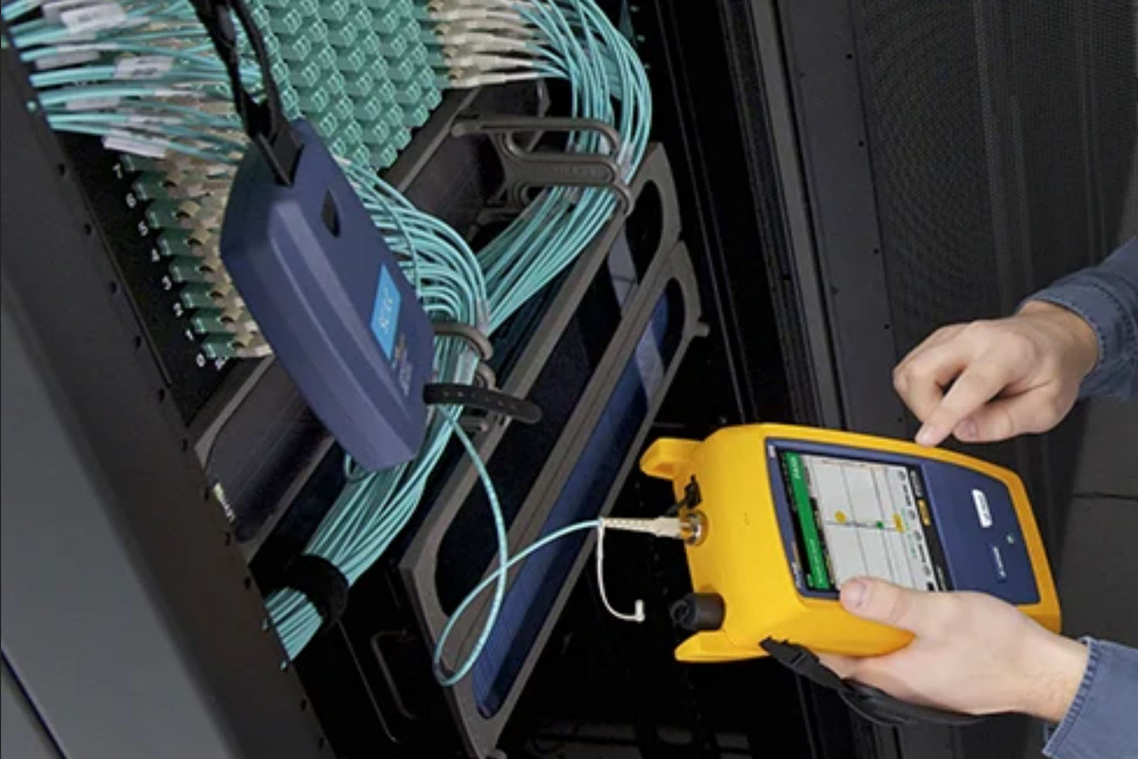 microngroup technician using fluke network cable tester for testing data cables