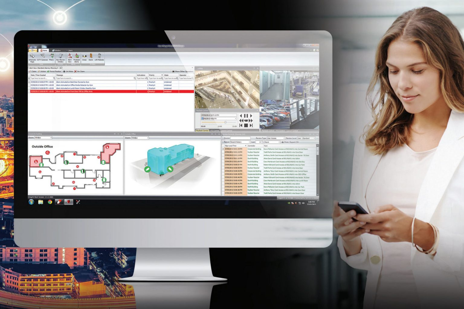 woman using integriti commercial access control software on imac