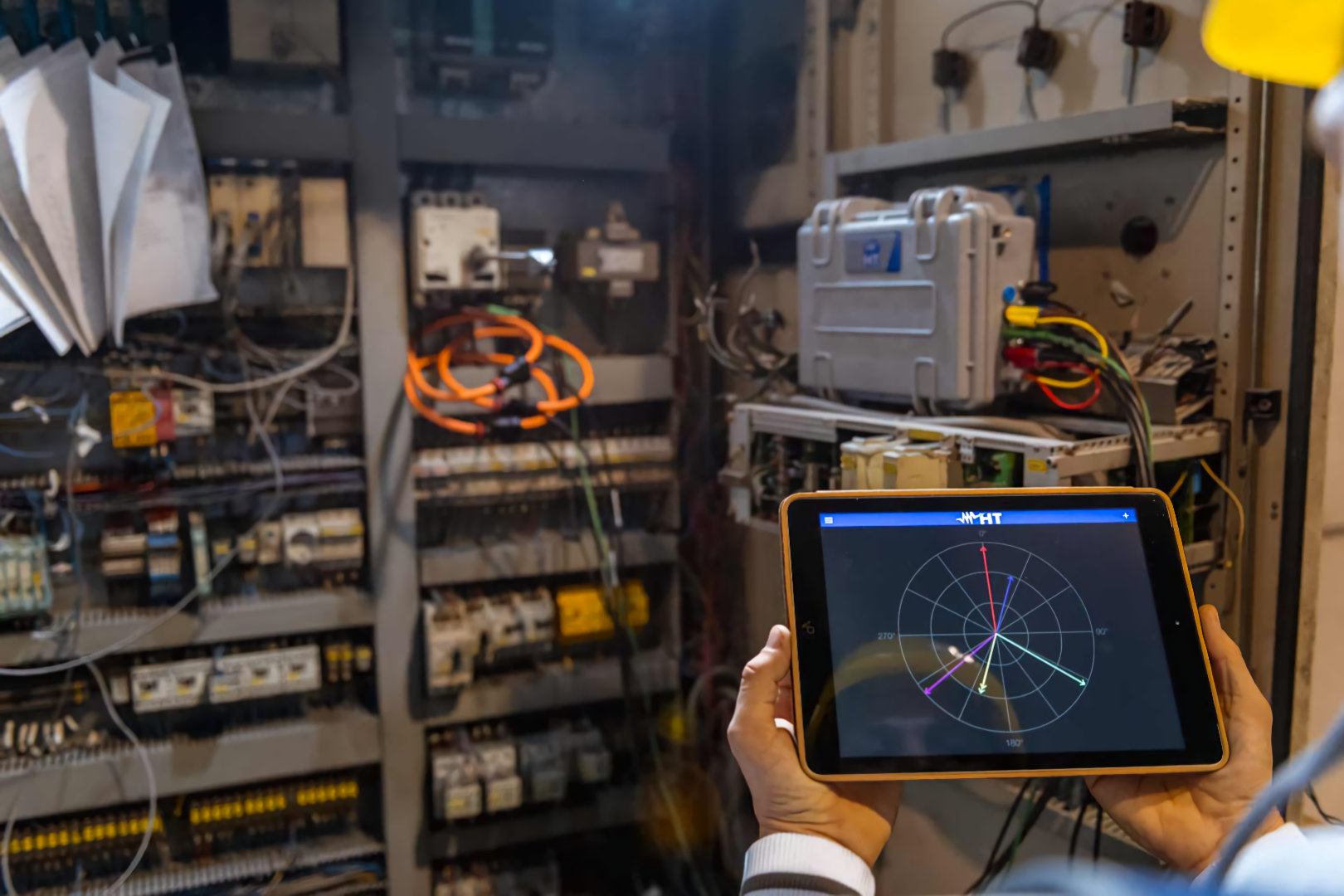electrician using power analysis equipment and software on ipad