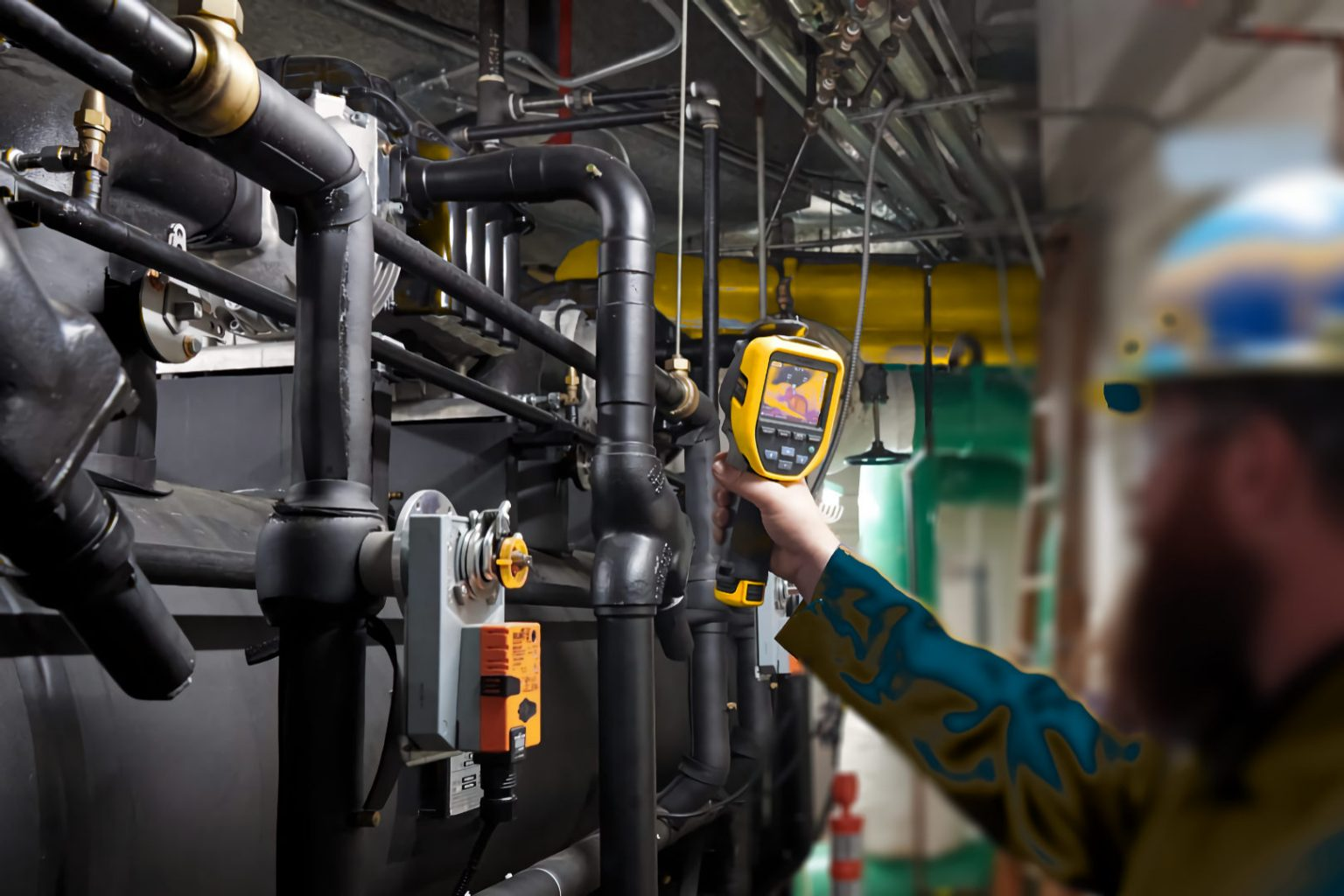 technician thermal scanning HVAC plant and chiller equipment